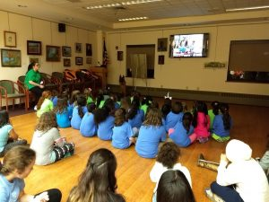 Exepnathos leads a PSAR presentation for a group of Girl Scouts